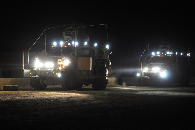 JOINT BASE BALAD, Iraq - Mine-Resistant Ambush-Protected vehicles light up the early morning darkness as members of the 15th Sustainment Brigade personal security detail prepare for a mission Jan. 27 at Joint Base Balad. (U.S. Army photo by Staff Sgt. Rob Strain, 15th Sustainment Brigade Public Affairs)