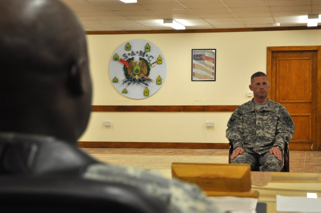 Sgt. Scott Todd, with the 3666th Maintenance Company, 541st Combat Sustainment Support Battalion, 15th Sustainment Brigade, 13th Sustainment Command (Expeditionary), answers questions before the Sergeant Audie Murphy Board Feb. 5 at Contingency Operating Location Q-West, Iraq. (U.S. Army photo by Staff Sgt. Rob Strain, 15th Sustainment Brigade Public Affairs)