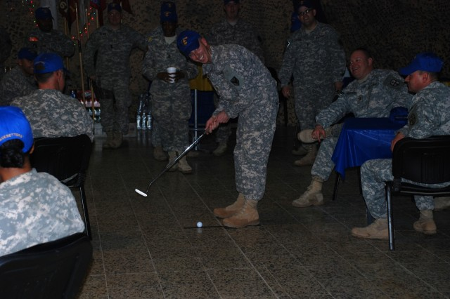 Maj. Steven Dowgielewicz, the 541st CSSB battalion executive officer, 15th Sustainment Brigade, 13th Sustainment Command (Expeditionary) of Amsterdam, N.Y., takes his turn representing Headquarters and Headquarters Company during the putting competition at the battalion's dining-in.