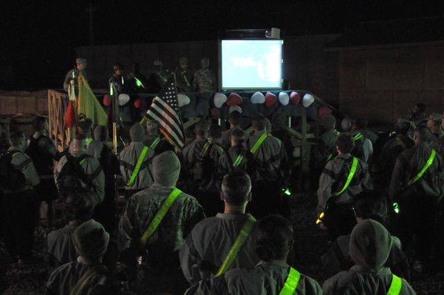 """Soldiers watch the Army's """"I. A.M. Strong"""" video before taking part in a theater-wide sexual assault awareness walk Feb. 12 at Contingency Operating Location Q-West, Iraq. (U.S. Army photo by Staff Sgt. Rob Strain, 15th Sustainment Brigade Public Affairs)"""