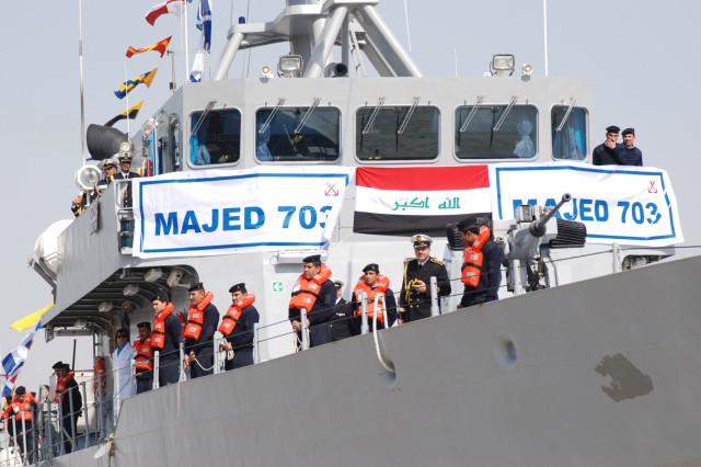 Iraqi sailors aboard the Majed 703 sail their ship in a parade displaying the Iraqi Navy's two newest ships at the Umm Qasr port in southern Iraq, Feb. 14. The Majed and the Shomokh 704 were christened during the display before they assumed their roles securing the ports and coastline of southern Iraq.