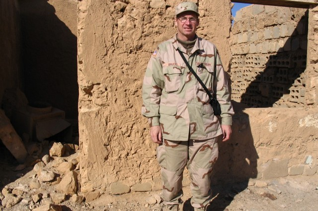 Kevin Bruce, a Civilian with New York District, stands in front of the ruins of what was once an old village in Western Iraq. Bruce deployed to Iraq twice to support the Corps of Engineers' efforts in the country.