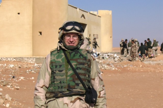 Kevin Bruce, a Civilian with New York District, stands in front of a recently constructed border fort along the Syrian border as it is inspected during his first (November 2004 to March 2005) of two Iraq deployments . This was one of a number of forts that were under construction at the time along the western border of Iraq.