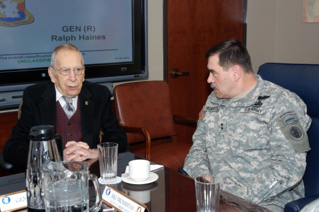 """(left to right) Retired Gen. Ralph E. Haines, Jr. and U.S. Army South Commanding General, Maj. Gen. Simeon G. Trombitas discuss current events at U.S. Army South's headquarters in historic """"Old BAMC"""" Feb. 11. (Photo by Robert R. Ramon, U.S. Army South Public Affairs/RELEASED)"""