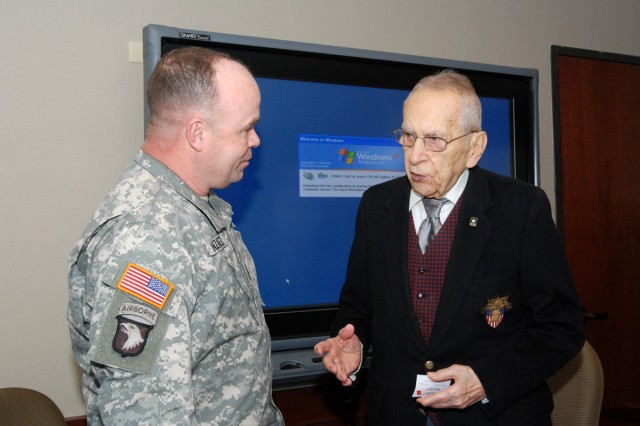 "Command Sgt. Maj. Luis Gonzalez (left), acting U.S. Army South command sergeant major and retired Gen. Ralph E. Haines, Jr. discuss the history of the U.S. Army Noncommissioned Officer Education System after a briefing at U.S. Army South's headquarters in historic ""Old BAMC"" Feb. 11. (Photo by Robert R. Ramon, U.S. Army South Public Affairs/RELEASED)"