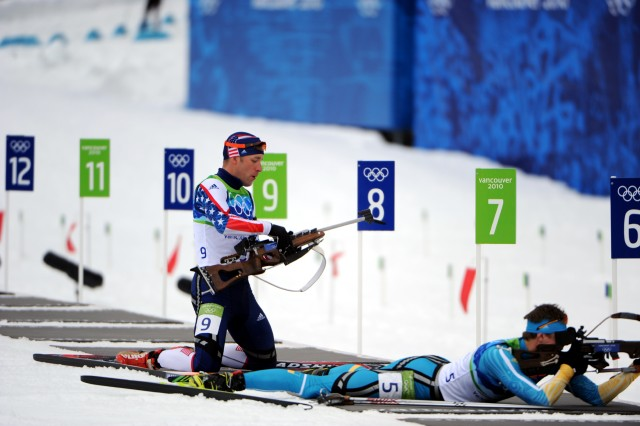 Sgt. Jeremy Teela realizes something is wrong as he prepares to go prone and shoot from the seventh position in the Olympic men's 12.5-kilometer pursuit at Whistler Olympic Park.