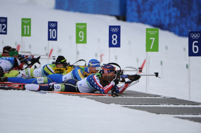 Sgt. Jeremy Teela (right) shoots a perfect 10 for 10 from the prone position en route to a 24th-place finish Tuesday in the men's 12.5-kilometer pursuit at Whistler Olympic Park.
