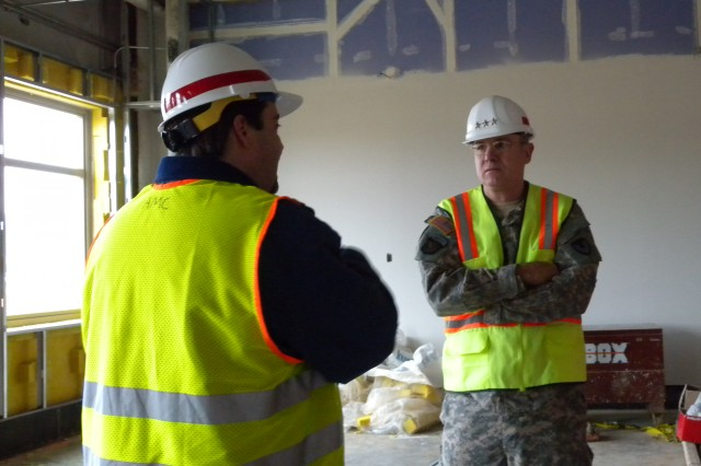 Mike Edwards explains the ongoing construction to Lt. Gen. James Pillsbury.