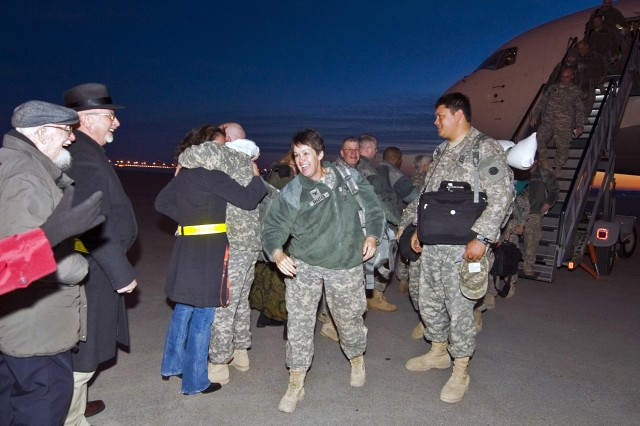 INDIANAPOLIS, Ind. - Soldiers of the 542nd Quartermaster Company, based in DuBois, Pa., and headquartered in Erie, Pa., are greeted with smiles and hugs at the Indianapolis International Airport as they return from a year-long deployment to Iraq, Feb. 13.