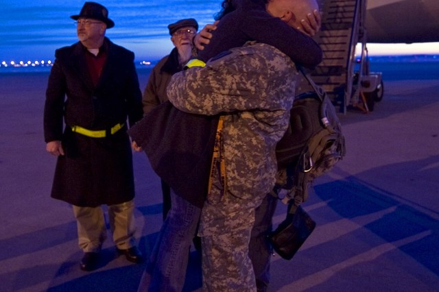 INDIANAPOLIS, Ind. - A Soldier hugs a loved one at the Indianapolis International Airport as the 542nd Quartermaster Company, based in DuBois, Pa., and headquartered in Erie, Pa., return from a year-long deployment to Iraq, Feb 13.