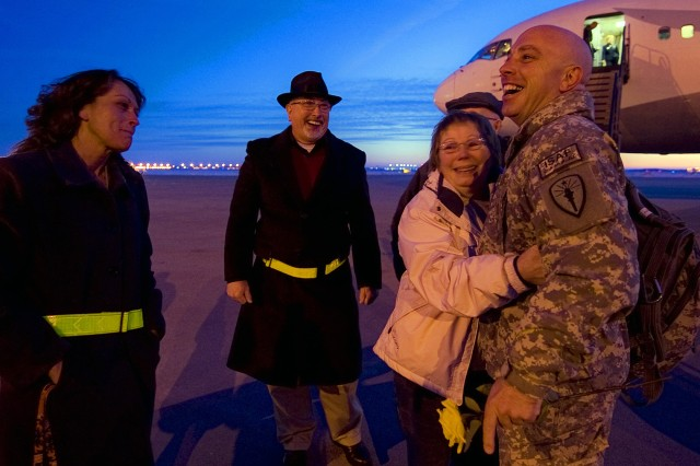 INDIANAPOLIS, Ind. - Soldiers and family members exchange smiles and hugs at the Indianapolis International Airport as members of the 542nd Quartermaster Company, based in DuBois, Pa., and headquartered in Erie, Pa., return home from a year-long deployment to Iraq, Feb 13.