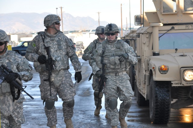 FORT CARSON, Colo.-Soldiers from the Protective Services Detail Team prepare for the extraction of personnel from a Humvee during training exercises.