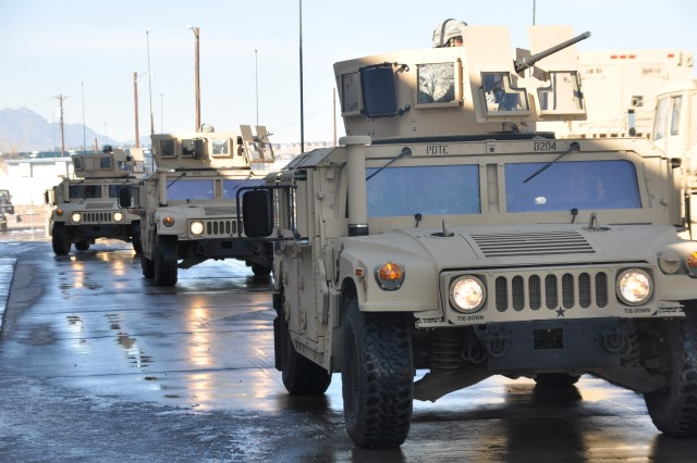 FORT CARSON, Colo.-The Protective Services Detail Team, 43rd Sustainment Brigade, roll along in their Humvees searching for potential dangers during training exercises, in preparation for deployment to Afganistan later this year.
