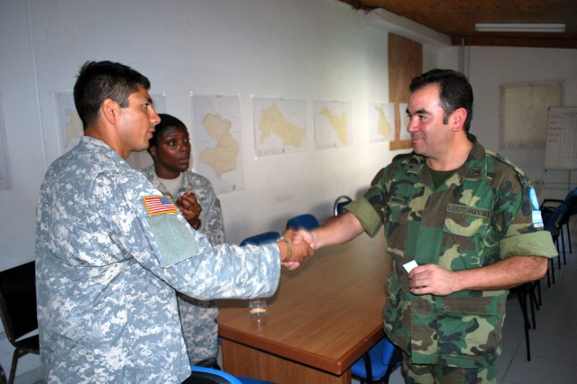 100216-N-5362A-001 ST. MARC, Haiti (Feb. 16, 2010) Capt. Valente, a civil affairs team leader under the Joint Forces Special Operations Component Command, concludes a meeting with a MINUSTAH representative from the Argentinean Army. The civil affairs team is working with the U.N., the Government of Haiti and non-governmental organizations to facilitate the distribution of humanitarian assistance. (U.S. Navy photo/Released)