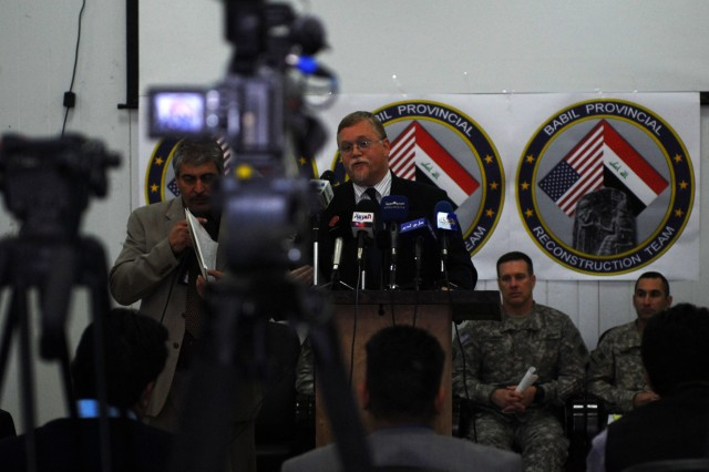 Rick Roberts, a team leader with the Babil Provincial Reconstruction Team, speaks during a press conference aimed at opening communication between U.S. personnel and Iraqi media at Forward Operating Base Kalsu, Feb. 15, 2010. According to Roberts, the PRTs have completed over 2,400 projects totaling nearly $155 million in the Babil Province.