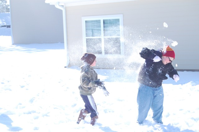 Michael Webster, 11, right, gets nailed by a snowball thrown at him by brother Gabriel Boucher, 7. The two, along with their 9-year-old brother Samuel Webster, were playing in the snow outside their home on Fort Jackson Saturday morning.