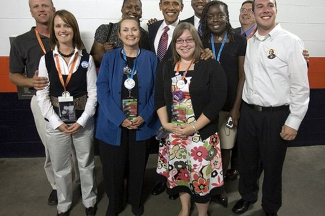 President Obama (Center) is surrounded by attendees.