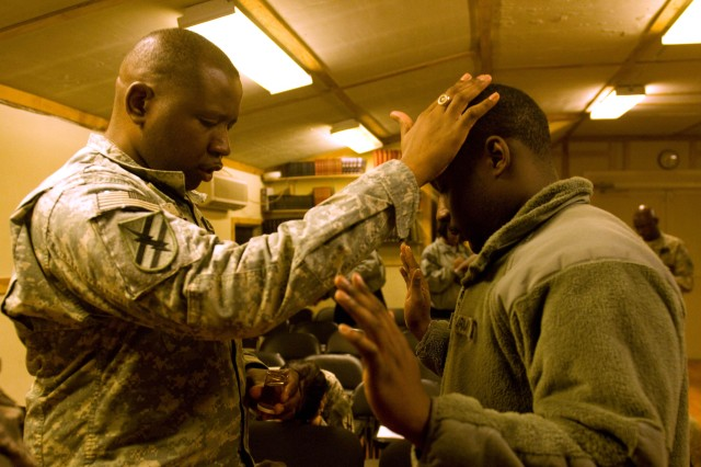 U.S. Army Capt. Markey Edwards, chaplain, 48th Infantry Brigade Combat Team, of Atlanta, Ga., anoints a Soldier with oil during an Ash Wednesday service, Feb. 17, at the base chapel on Camp Phoenix, Kabul, Afghanistan. The service featured traditional and contemporary worship music as well as an anointing with oil.