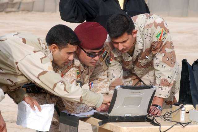 Iraqi Army soldiers discuss the control system for the RQ-11 Raven miniature unmanned aerial vehicle at the Iraqi Army's 3rd battalion, 32nd Brigade compound in Wasit Province, Iraq, Feb. 16, 2010. During the training, Iraqi Army soldiers learn how to assemble the MUAV, establish a link with the computer system, set waypoints and launch the Raven into the air.