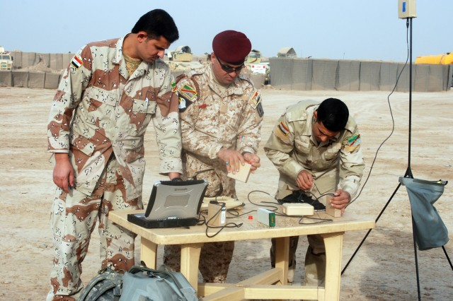 Iraqi Army soldiers set up the control system for the RQ-11 Raven miniature unmanned aerial vehicle at the Iraqi Army's 3rd battalion, 32nd Brigade compound in Wasit Province, Iraq, Feb. 16, 2010. The training is another step in the Iraqi Army's taking over of full responsibility for the country's security.