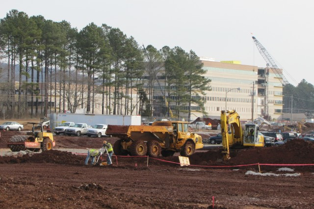 Visitors to Redstone Arsenal - including next week's visit by Installation Management Command commander Lt. Gen. Rick Lynch - often see the physical signs of the Arsenal's growing work force and command footprint. This is the construction work site for the new Redstone Test Center. In the background is the new Army Materiel Command headquarters, which is nearing completion.
