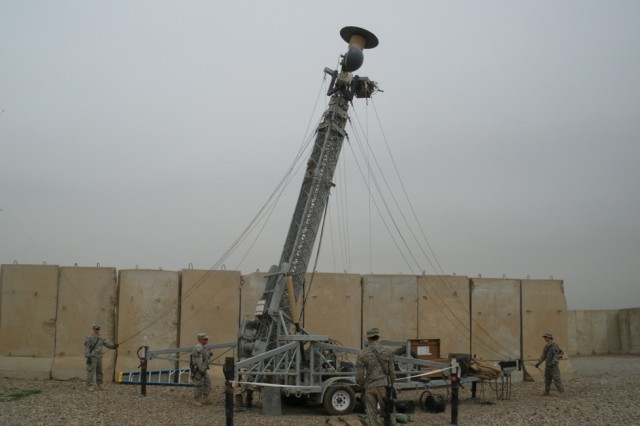 A Rapid Aerostat Initial Deployment tower, which is part of the Base Expeditionary Targeting System of Systems-Combined, is raised on a base in Afghanistan to provide the warfighter a fully-integrated, operationally-relevant ISR and Force Protection capability with integrated views of multiple points of situational data.