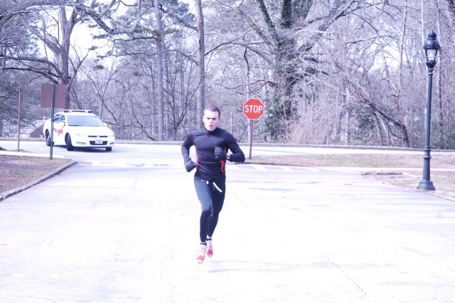 Chief Warrant Officer 2 Ron Hicks, a voice interceptor with the 345th Military Intelligence Battalion, sprints to the finish line of the Valentine's Day 5-km run at Fort McPherson Feb. 11. Hicks was the first runner to cross the line at Hedekin Field with a time of 17:43.