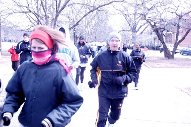 A group of runners begin their attempt at the Valentine's Day 5-km run at Fort McPherson Feb. 11. Ninety people braved the cold to challenge themselves on the course, which started at Hedekin Field in front of U.S. Army Garrison headquarters.