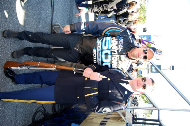 Staff Sgt. Mark Hyatt of the U.S. Army Drill Team stands with Harry Connick Jr. at the Daytona 500 on Feb. 14. Connick sang the National Anthem before the race.