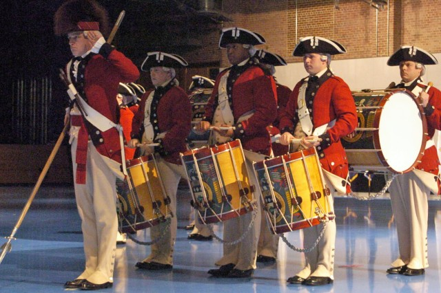 A portion of the Old Guard Fife and Drum Corps salutes during a ceremony Feb. 13, at Joint Base Myer-Henderson Hall, Va., marking the unit's 50th anniversary.