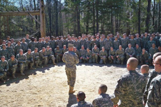 Recruits listen to a briefing Wednesday prior to their first Army challenge - the confidence course at Sand Hill.
