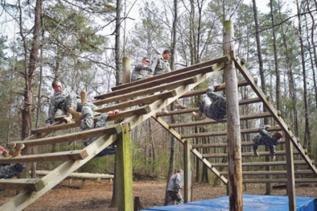"The recruits headed out to the Sand Hill Obstacle Course Thursday and negotiated more than 25 challenges, like ""The Weaver"" above."