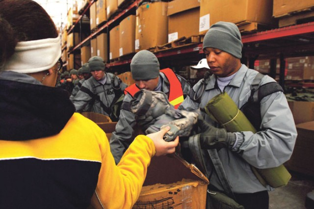 Recruits are issued military equipment at Sand Hill's Central Issuing Facility. Soldiers received elbow and knee pads, sleeping mats, sleeping bags, tents and other equipment they will need in the coming weeks.