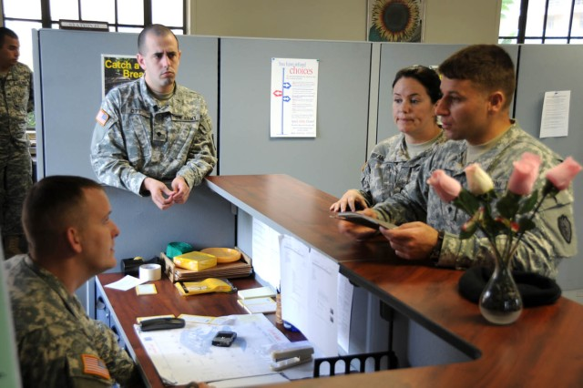 U.S. Army Specialist Elnur Iskandarov and Specialist Mary Iskandorov meet with tax personnel for assitance at the Schofield Barracks Tax Center Jan. 27 at Schofield Barrracks.