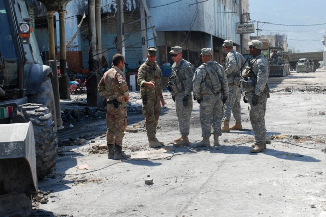 An Italian soldier clears the streets of Port-au-Prince, Haiti, on Feb. 17. Paratroopers with 2nd Brigade Combat Team, 82nd Airborne Division partnered with the Italians and the Center of National Equipment for the rubble removal mission. (U.S. Army photo by Pfc. Kissta M. Feldner, 2BCT, 82nd Abn. Div. PAO)