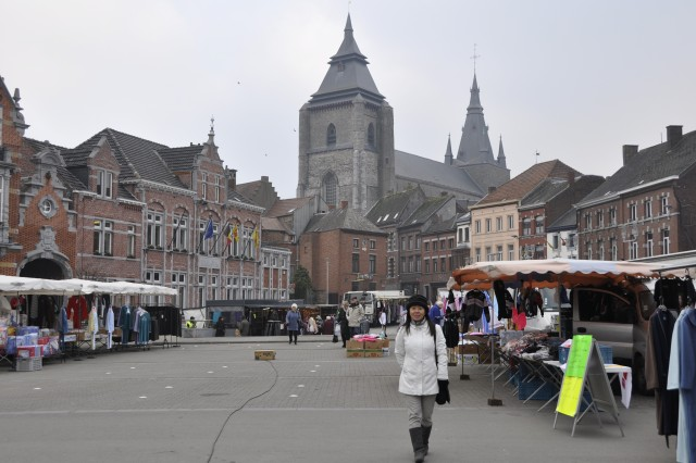 Yumi Takushi, the first member of the ChiAfA..vres Garrison Ambassador Program, visits her town square in Soignies, Belgium, during market day to explore what the village has to offer.