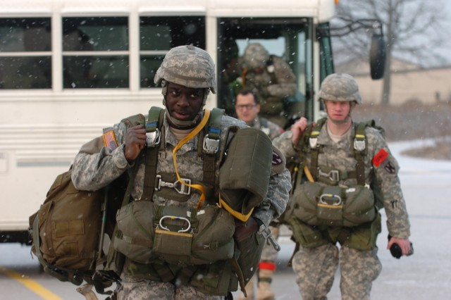 Soldiers from the 5th Quartermaster Company, 21st Special Troops Battalion, 21st Theater Sustainment Command, step off a bus to board an Air Force C-130J Super Hercules cargo plane at Ramstein Air Base Feb. 10. 5th QM conducted a jump with the drop zone near Marnheim, Germany.
