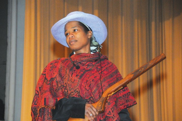 """Staff Sgt. Marva Austin, G Company, 244th Quartermaster Battalion, 23rd Quartermaster Brigade, plays the part of Harriet Tubman in a skit called """"Glory Train."""" The skit was part of a African-American History Month program held Feb. 11, on Fort"""
