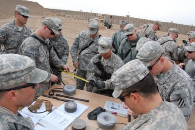 Soldiers from the 1st Battalion, 15th Infantry Regiment, 3rd Heavy Brigade Combat Team, 3rd Infantry Division, learn how to make a window charge in a demolition class Feb. 9, 2010, as part of the battalion's Team Leader Course at Forward Operating Base Echo, Iraq.