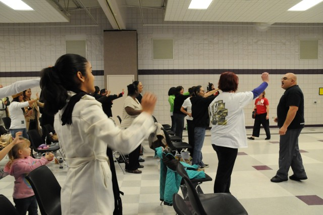 Lioni Velasquez, far right, lead instructor at Musha Dojo in Fayetteville, teaches participants how to perform a palm-heel strike during the Heart Camouflage Safe Spouse seminar Feb. 6, at Honeycutt Recreational Center. The audience also learned about personal and home safety.