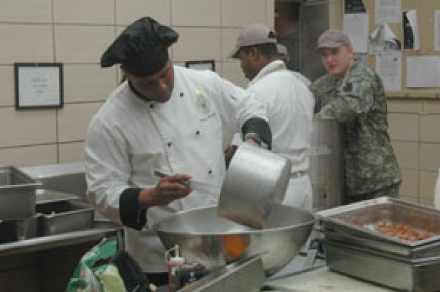 "Sgt. Darius Hamilton, food service specialist, Company F, Forward Support Company, 2nd Battalion, 30th Infantry Regiment stirs potatoes while preparing meals for an ""Iron Chef"" competition Jan. 29."