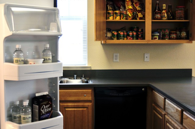 The cupboards and fridge were stocked with food for the Webber family provided by Clark Pinnacle and OMC Commissary.