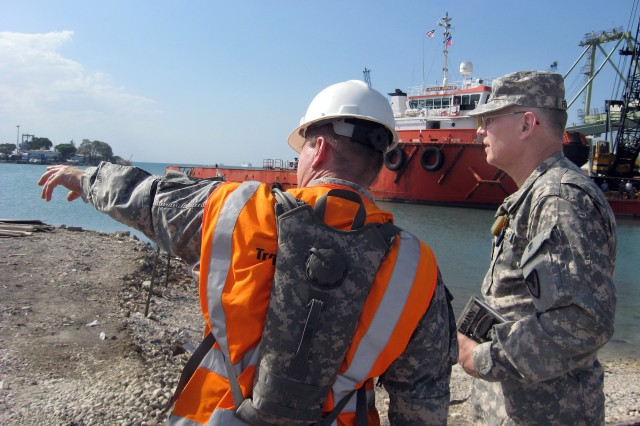 Lt. Col. Ralph Riddle, 832nd Transportation Terminal Battalion, explains Sea Port of Debarkation operations to Col. Steven J. Feldmann, Army Sustainment Command's deputy commanding general for mobilization. Feldmann is heading-up Army Material Command's efforts in Haiti.