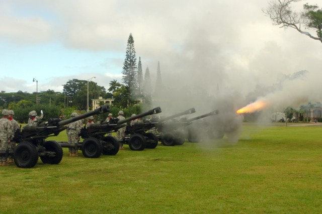 A salute battery from 3rd Battalion, 7th Field Artillery Regiment fires 13 rounds in honor of Maj. Gen. Robert L. Caslen Jr., the outgoing commanding general, 25th Infantry Division, during a change of command ceremony held on Sills Field at Schofield Barracks, Hawaii, Feb. 19. (U.S. Army photo by Spc. Jesus J. Aranda, 25th Infantry Division Public Affairs Office)
