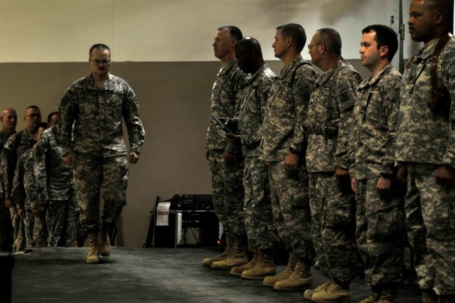 The 90th Sustainment Brigade command staff, out of Little Rock, Ark., 13th Sustainment Command (Expeditionary), prepares to pin awards on the brigade's Soldiers during its end-of-tour award ceremony Feb. 15 at Joint Base Balad, Iraq.