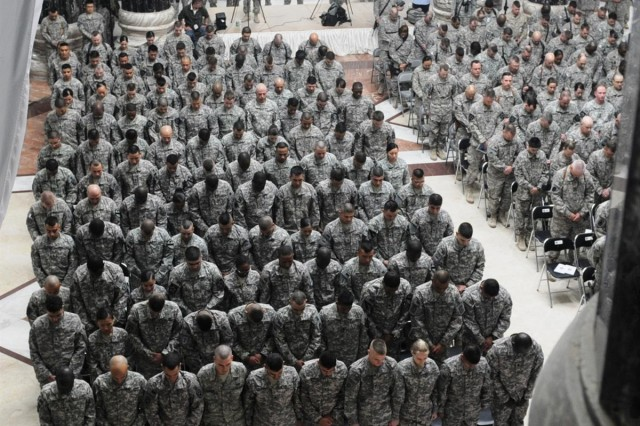 One hundred and seven Soldiers raise their right hand as they take the oath of citizenship in a ceremony Feb. 15 in Al-Faw Palace at Victory Base Complex, Iraq. Soldiers representing 44 countries became citizens in the 16th United States Forces - Iraq naturalization ceremony.