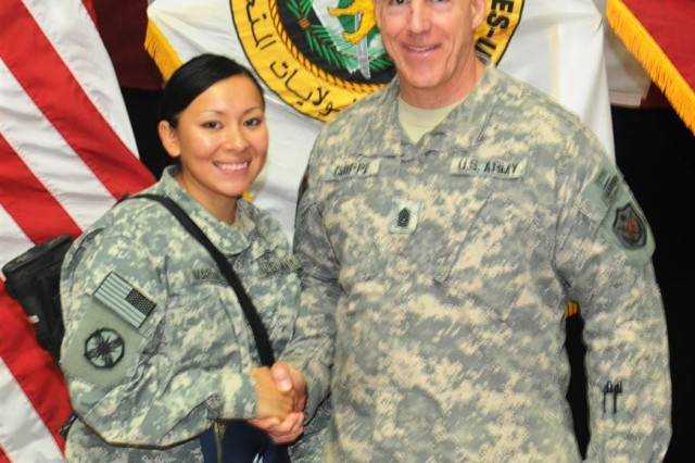 Command Sgt. Maj. Frank A. Grippe, command sergeant major for 1st Corps, congratulates Pfc. Edilma Martinez, a transportation logistics specialist with the 612th Movement Control Team, 49th Transportation Battalion, 15th Sustainment Brigade, 13th Sustainment Command (Expeditionary), after the United States Forces - Iraq naturalization ceremony Feb. 15 in Al-Faw Palace at Victory Base Complex, Iraq. Martinez, an Inglewood, Calif., native, was one of 107 Soldiers who became a U.S. citizen that day.