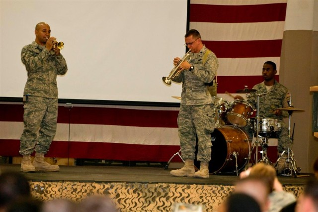 The H-6 Jazz Trio performs an improvised blues song for the Black History Month observance luncheon Feb. 19, at Joint Base Balad, Iraq.