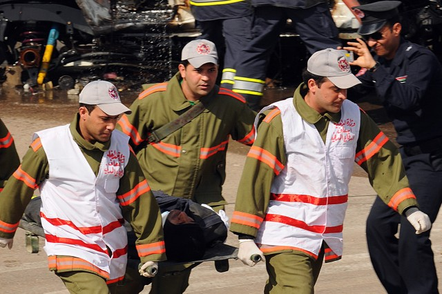 BAGHDAD - Medics used their skills to assess and evacuate victims in a demonstration Feb. 17 at the Iraqi Civil Defense Directorate Academy. The demonstration finalized the graduation ceremony of the Academy's newest class. (U.S. Army photo by Sgt. Samantha Beuterbaugh, 366th MPAD, USD-C)