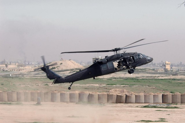 A UH-60L Black Hawk from Company A, 2nd Battalion, 25th Aviation Regiment, assigned to Task Force Lightning Horse, lands during a simulated air assault with a Combined Security Force element at the Kirkuk Training Center, outside of Contingency Operating Site Warrior, Feb. 15.   (Photo by:  Sgt. 1st Class Tyrone C. Marshall  25th Combat Aviation Brigade Public Affairs)